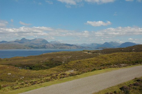 A spectacular view from the Applecross Coast Road looking across Loch Torridon towards the Torridon Hills.