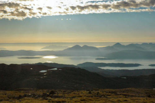 The view from the car park at the top of the Bealach na Ba with the Cuillins on Skye clearly visible.